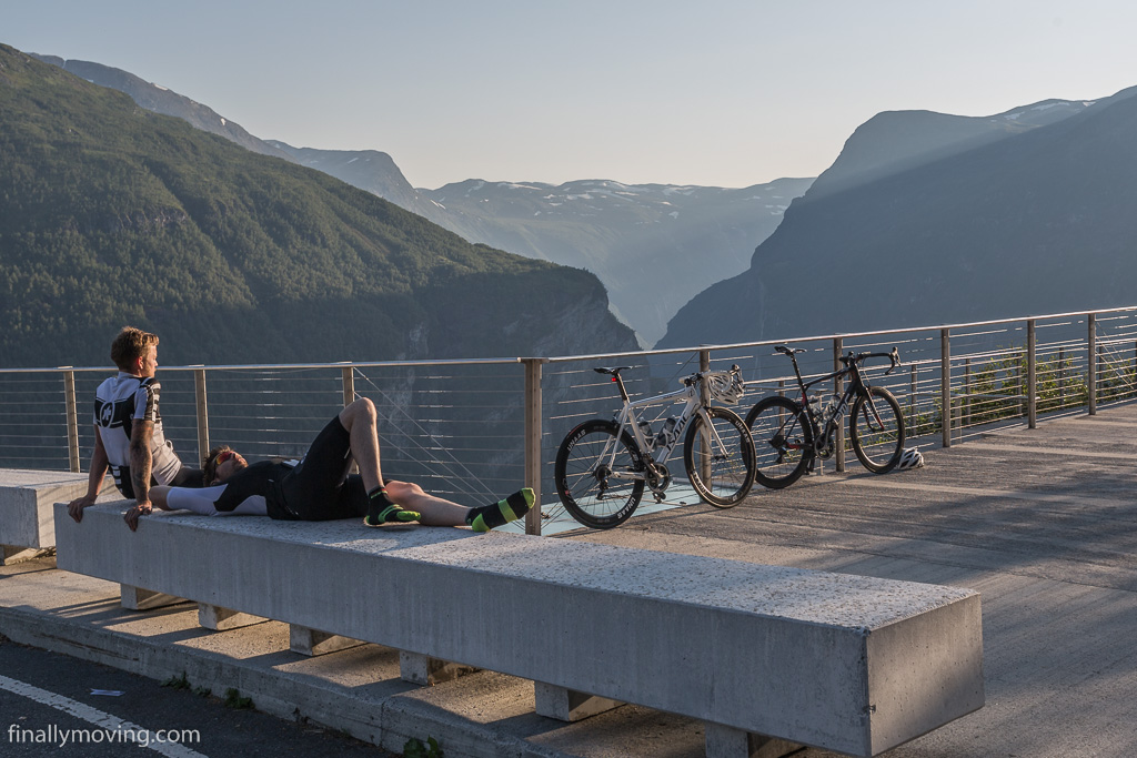 Cyclists taking a break after the climb up the serpentine road from the fjord